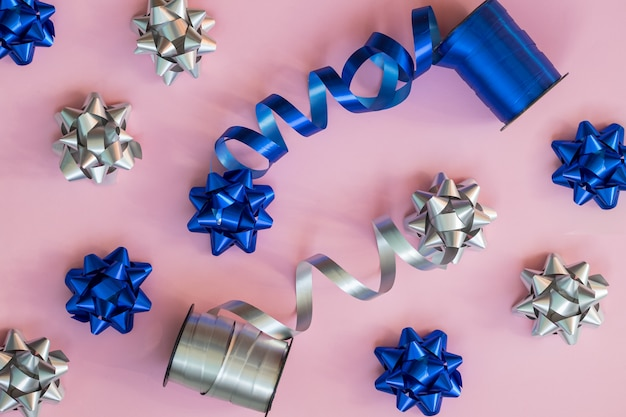 Holiday background. blue and silver gift bows.packaging materials.preparing christmas gifts.fashion composition for new year or wedding.