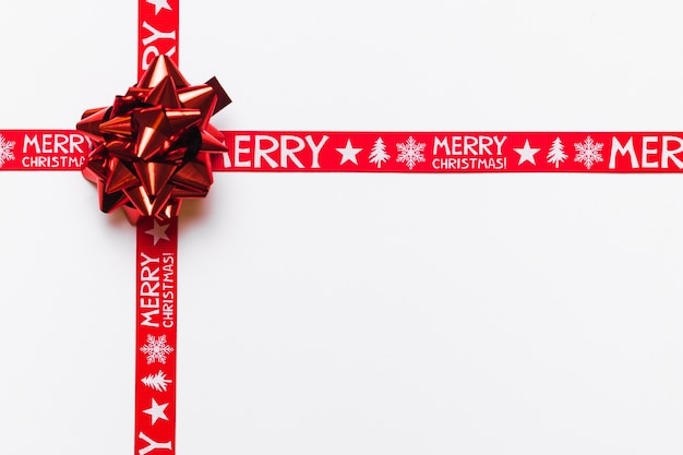 Holiday background of red ribbons with bow