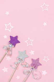 Holiday background with bright stars and festive decor concept of children girl birthday party