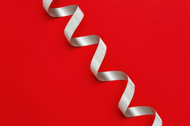 Holiday background with copy space. silver spiral ribbon
