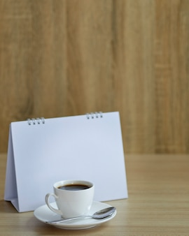 Holiday concept coffee and empty calendar