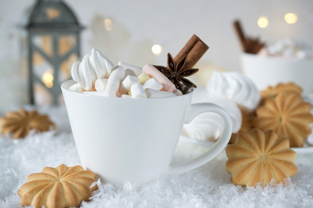 Holiday cup of  cocoa with marshmallow or coffee with spice and home cookies. christmas concept