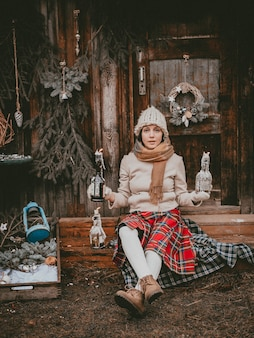 Holiday decoration woman creates christmas atmosphere open air rustic minimalistic modern from natural ecological materials scandinavian style. ideas decorating new year with your own hands handmade.