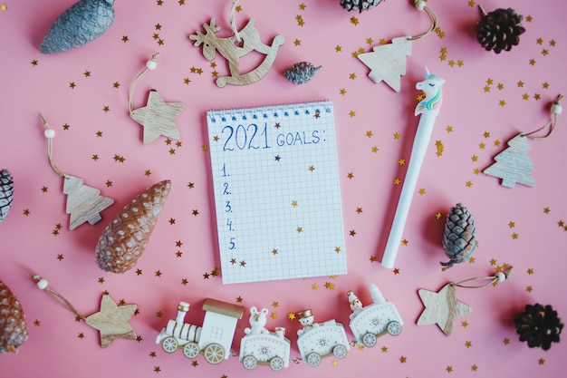 Holiday decorations and notebook with 2021 goals, plans, dreams