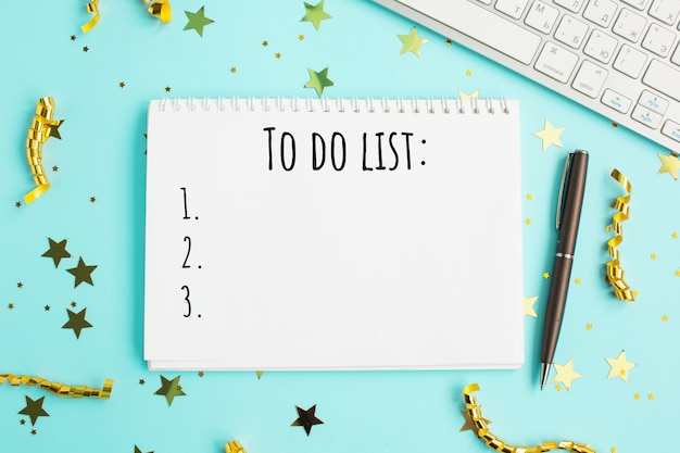 Holiday decorations and notebook with 2021 to do list.