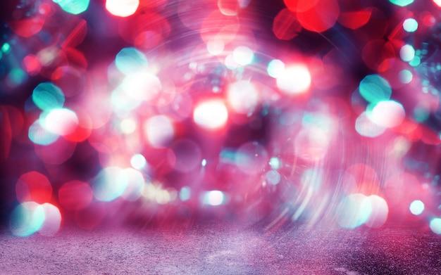 休日の夜とパーティーライト。キラキラヴィンテージライトの背景。焦点がぼけたボケ効果。背景、広告やデザインの壁紙、デバイス。コピースペース。魔法のきらめき。