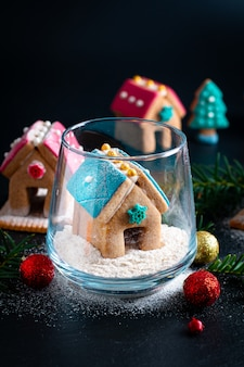 Holiday food diy pastel christmas cookies, gingerbread houses, and christmas tree for gift or party