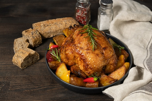 Holiday food roast chicken or poultry with potatoes and vegetables