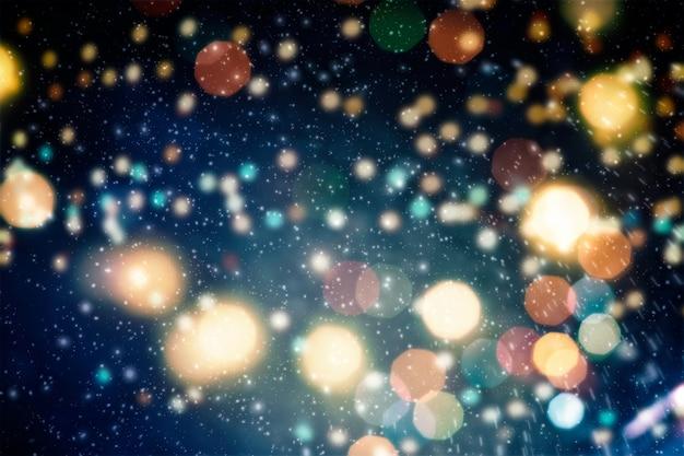 Праздник светящийся фон. праздничный новогодний фон. элегантный абстрактный фон с расфокусированными огнями боке и звездами