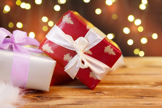 Holiday greeting card with gift boxes against blurred lights background