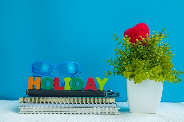 Holiday letters text and notebook paper and little tree