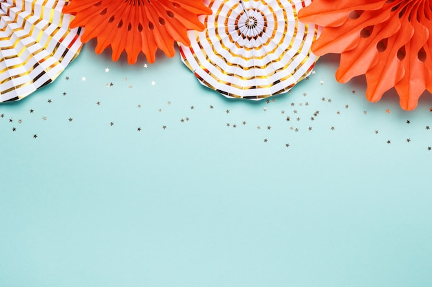 Holiday party background. trendy paper coral and gold decoration on turquoise background.