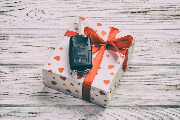 Holiday present with red hearts, car keys and gifts box