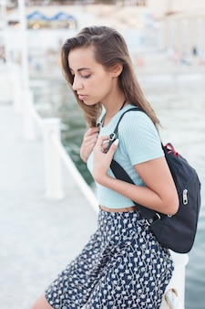 Holiday, resort, tourism concept - individuality: portrait of a beautiful young woman at the sea
