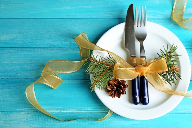 Holiday table setting with christmas decoration