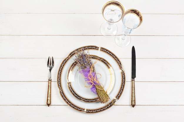 Holiday table setting on wooden table in lilac colors