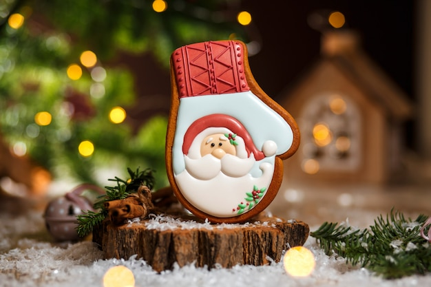 Holiday traditional food bakery. gingerbread santa claus glove in cozy warm decoration with garland lights