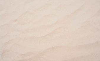 休暇旅行砂浜の背景のテクスチャ。