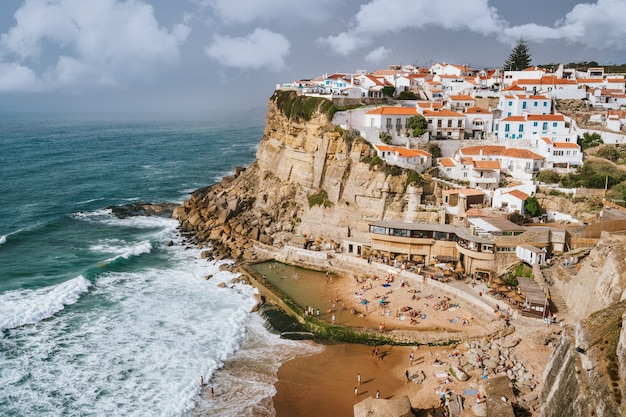 Holiday vibes on beautiful azenhas do mar village and wave protected beach
