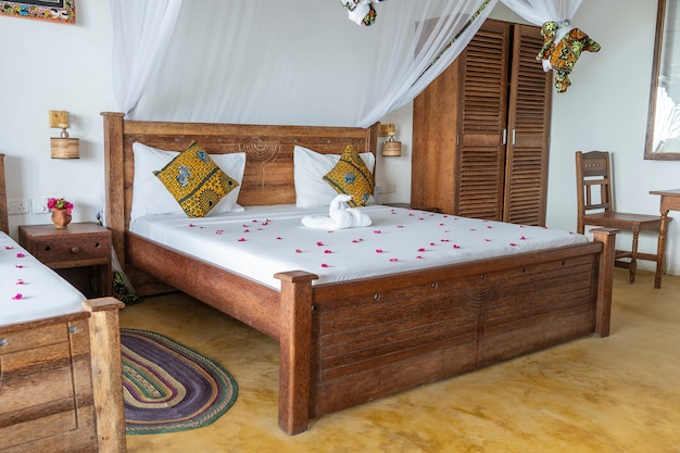 Holiday villa bedroom with four poster bed