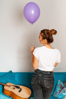 Holiday. young girl with balloons. in room. party. congratulations.