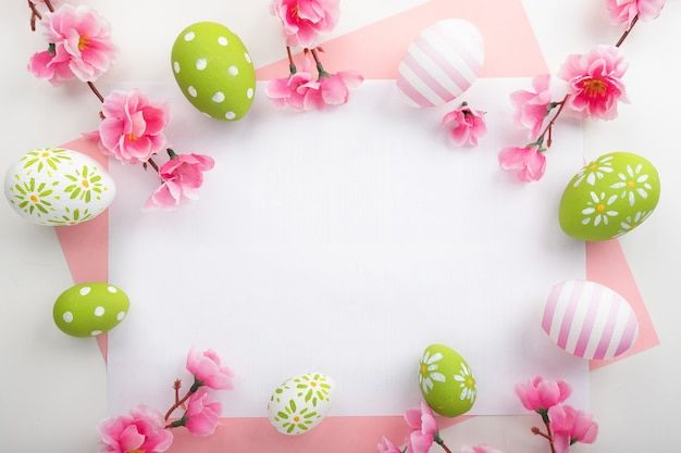 Holidays background with easter eggs on pink background