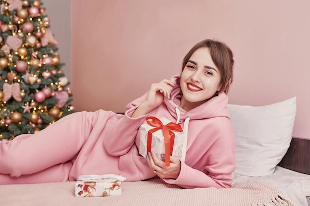 Holidays, celebration, happy girl with gift box