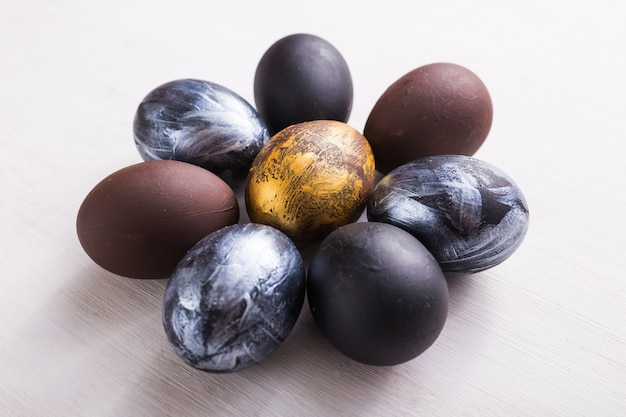 Holidays, design and modern easter concept - black and brown easter eggs style minimalism