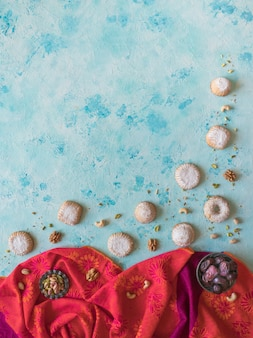 Holidays food background. arab sweets are laid out on a blue table.