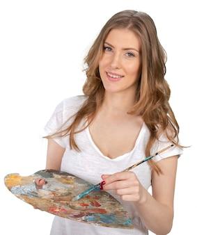 若くてきれいな女性holing絵筆とパレット
