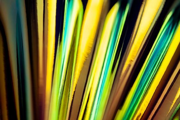 Голографический абстрактный красочный фон. голографическая цветная морщинистая фольга. радужное искусство. размытый фон.
