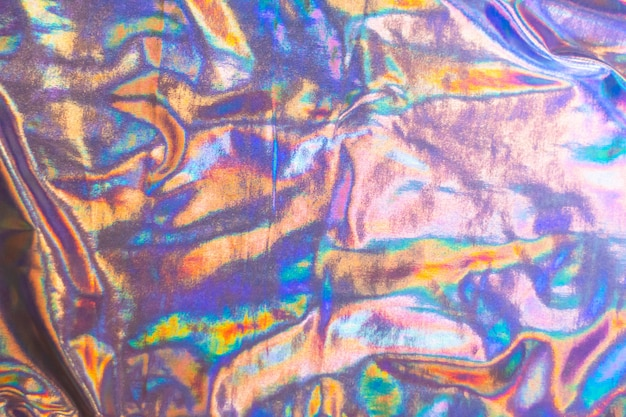 Holographic iridescent mermaid foil texture background. futuristic neon trendy silver colors