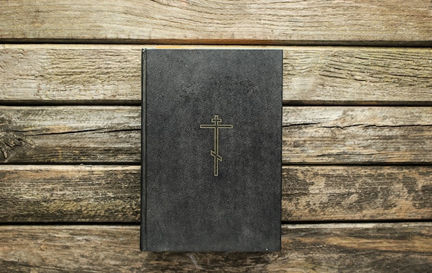 Holy bible book on old rustic boards. religion concept