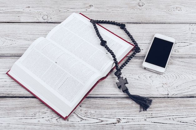 Holy bible and smartphone