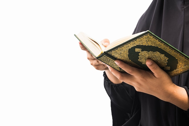 Holy book of muslims koran in hand
