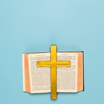 Holy book opened with wooden cross