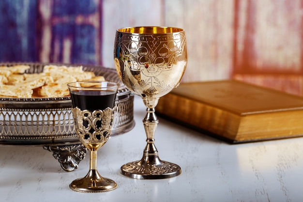 Holy communion on wooden table on church. cup of glass with red wine