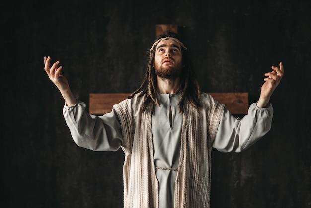 Holy great martyr praying, cross on black