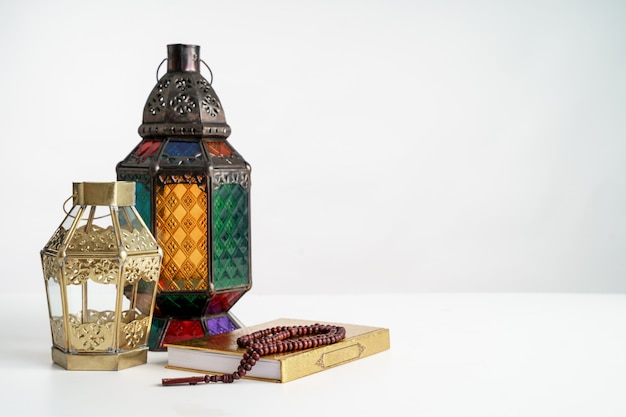Holy quran and arabic lantern background