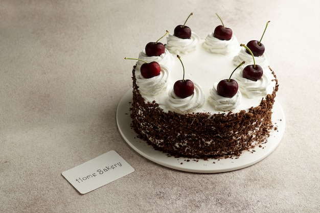 Home bakery consept, cake black forest and card
