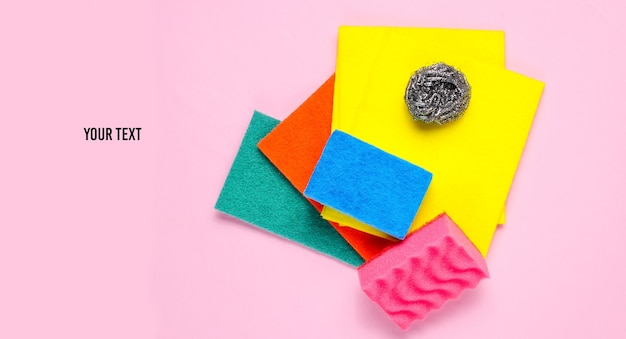 Home and bathroom cleaning kit on pink background. sponges, abrasives.