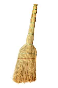 Home broom for cleaning debris isolated on a white background.