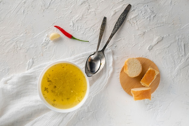 Home cooked boullion or clear soup in a ceramic bowl at the kitchen, healthy food and diets