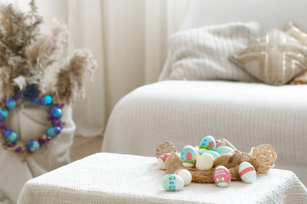 Home cozy interior with easter decor on the table.