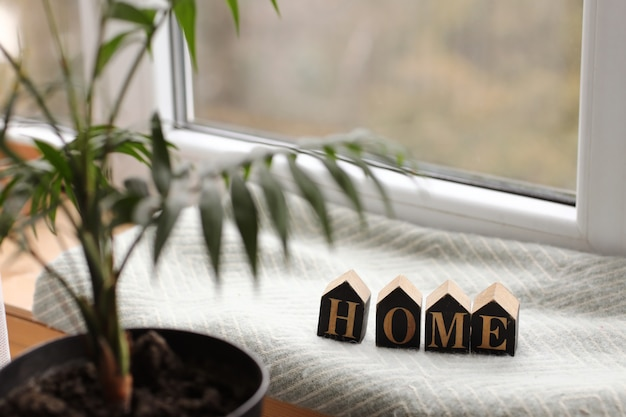 Home decor in a cozy house with wooden letters with the inscription home