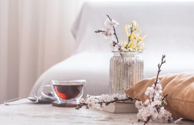 Home decor in living room cup of tea with spring flowers