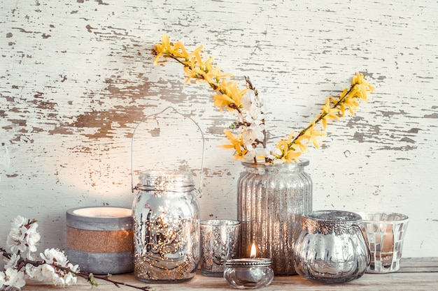 Home decor on wooden wall with spring flowers