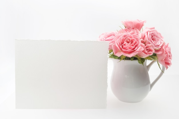 Home decoration, empty card and cup with roses isolated