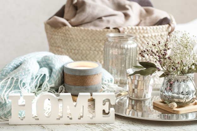 Home decorations in the interior of a letter with an inscription home on a wooden table