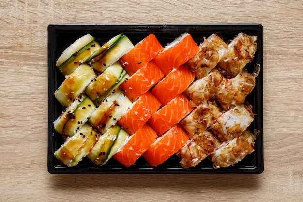 Home delivery of sushi set in a plastic box.